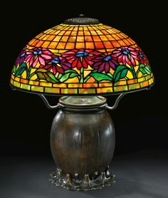 "** Tiffany Studios, New York, Favrile Leaded Glass and Patinated Bronze ""Poinsettia"" Lamp."
