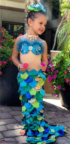 To recreate Vintage Little Mermaid, all your tot needs is her own skin-toned tank and then you can create the mermaid tail and bikini top by cutting up green and blue clothing.