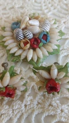 Very old, celluloid brooch with matching screw - back earrings..covered with tiny seashells...earrings resemble a flower all arrange by tiny shells...Estimating. 1940,s...good cond. Wear to pin back..but clasp works fine...Very rare piece...true Tropical Vintage....and quite the collectable !!! | eBay!