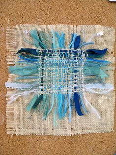 Lesley Turner. looks like woven into the background fabric of a loose linen like
