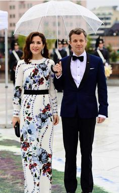 Crown Princess Mary of Denmark in floral long-sleeved gown at the Opera House on the ocassion of the celebration of King Harald and Queen Sonja of Norway 80th birthdays on May 10, 2017 in Oslo, Norway.