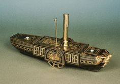 Photo #64 of #707070. In June 1819 the SS Savannah was the first paddle ship steamer to cross the Atlantic. Here is a lacquer model of a steam ship - now sold.
