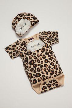 Leopard Baby Girl Onesie Set Short Sleeve Onesie set with off White Chiffon Flowers and Rhinestones. $25.00, via Etsy.