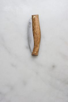 Navaja is a term used in Spain to describe folding knives, and this pocket-sized example is as nice as they come. Made of thoughtfully-shaped olive wood, each knife is punctuated with three brass pins.