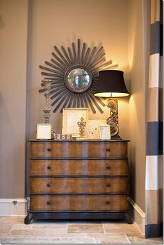 The cabinet fits snuggly in a small niche. The lamps are especially darling.