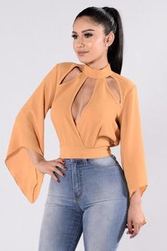 - Available in Mustard - Blouse Top - Open Front Chest Design - Bell Sleeves - Slightly Cropped - Key Hole Back - Made in USA - Polyester Spandex Classy Outfits, Chic Outfits, Fashion Outfits, Blouse Styles, Blouse Designs, Girl Fashion, Women's Fashion, Fashion Belts, Fashion Socks
