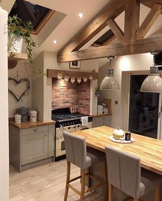 We all love a good dose of @no14hectorshouse kitchen don't we! 💚 Oak Ceiling Beam Envy! 💚💚
