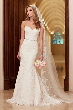 Stella York 6124 - We love the elegant simplicity of this strapless gown – the fabric is stunning and the waist-cinching belt is a simple detail that really finished the dress off perfectly.