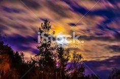 Beautiful moon scene on a cloudy sky Royalty Free Stock Photo