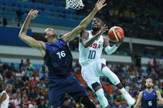Best images from Aug. 14 at the Rio Olympics:      United States guard Kyrie Irving (10) prepares to shoot the ball as France center Rudy Gobert (16) defends during the men's preliminary round in the Rio 2016 Summer Olympic Games at Carioca Arena 1.