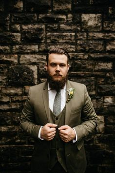 Olive green groom style and succulent boutonniere | Image by Swatch Studios
