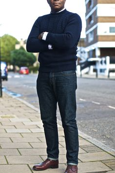 Navy sweater, white shirt, dark jeans, loafers