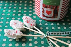 Peppermint spoons for hot cocoa...melt white chocolate over a double boiler than stir in crushed up candy cane. While the chocolate is still hot, dip in wooden spoons than let dry on a piece of wax paper. Wait until the chocolate hardens to package up