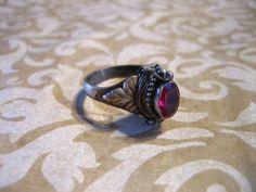 Vintage Sterling Silver and Garnet Poison Ring w Secret Compartment Poison Ring, Secret Compartment, Vintage Wear, Jewelries, Garnet, Antique Jewelry, Random Stuff, The Secret, Death