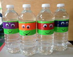 Teenage Mutant Ninja Turtle water bottles. Items needed: Water bottles Duct tape Google eyes Black permanent marker