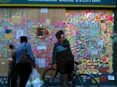 Peckham Peace Wall - This shop on Rye Lane in Peckham had it's windows smashed in by rioters last Monday, the local public reacted by covering the then boarded up windows in reasons that they love Peckham. (Holle Berry)