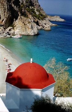 Church of Kira Panagia with red dome, overlooking the beach. Island of Karpathos, Dodecanese, Greece