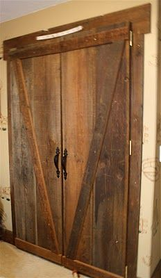 Vintage old barn doors as closet doors in a childs bedroom.