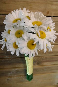 Pretty meadow-style bridal bouquet featuring leucanthemum daisies with lemon yellow ribbon
