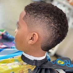 Wavy Fade Check out the coolest black boys haircuts we have put together in our gallery. Here you will find a short curly hair mohawk with a fade, a low taper with curls, waves with a side part and many other trendy hairstyles for kids. Black Boys Haircuts Fade, Boys Fade Haircut, Little Boy Haircuts, Haircuts For Men, Curly Mohawk Hairstyles, Trendy Hairstyles, Black Boy Hairstyles, Office Hairstyles, Anime Hairstyles