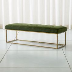 Shop Channel Dark Green Velvet Bench. Here's a luxurious little jewel for the foot of the bed or any place you need extra seating. Upholstered in deep green velvet the brass-framed bench is tailored with channel stitching. The Channel Dark Green Velvet Bench is a Crate and Barrel exclusive.