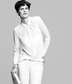 PREMIUM QUALITY. Sheer silk blouse with rounded collar and gathers at neckline. Concealed front buttons. Pearlescent buttons at cuffs.