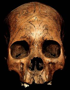 DAYAK TRIBE: HEAD HUNTING HUMAN TROPHY SKULL #14  HAND CARVED HUMAN SKULL BONE.  THE DAYAK TRIBE, FROM BORNEO ISLAND  INDONESIA, CARVE DESIGNS INTO THE SKULLS  OF THEIR HEADHUNTED VICTIMS AND INSERT WOODEN FIGURES.