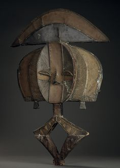 Africa   Reliquary figure ~ mbulu-ngulu ~ from the Kota people of Gabon   Wood, covered with brass and metal