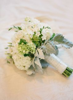 White and green Hydrangea with white freesia and dusty miller foliage bouquet
