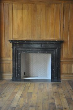 Marble Black Fireplace Mantel surrounds modern contemporary French