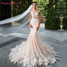 741264f2f43a Aliexpress.com   Buy Luxury Champagne Mermaid Wedding Dresses Lace Backless Turkey  Vestidos de noiva Appliques Arab Bridal Wedding Gowns Z988 from Reliable ...