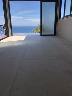 """Compressed cement fibre boards as our flooring for our back beach """"shed"""". Haven't coated yet. Love the finish and heavy feel. A lot cheaper than polished concrete."""