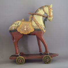 Hand carved and painted wooden horse on wheels.  Possibly child's toy from India.
