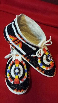Cheyenne moccasins. Old style design on toe with a modern flare. By SCOTT SUTTON  July 2015  11/0 cuts on brain tanned buckskin with Latigo soles.