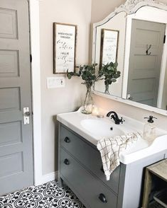 Farmhouse bathroom with white neutral colors, chippy paint, eucalyptus floral, a rustic Bible verse sign, and an Antique Candle Works candle for a totally completed style! Can't get enough of the vibes in this room - how to create the perfect modern farmh Modern Farmhouse Bathroom, Farmhouse Ideas, Farmhouse Style, Country Bathrooms, Cottage Farmhouse, White Farmhouse, Ideas Hogar, Bathroom Renos, Master Bathroom