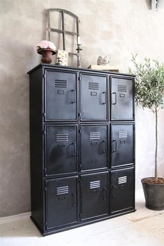 Jeanne d'Arc black metal cabinet with an industrial look for a hallway or workroom. 90 x 35 x 125cm