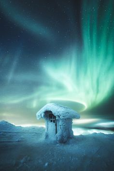 Northern lights above the arctic toilet in Levi, Finland