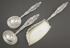 A SET OF THREE WHITING LILY OF THE VALLEY PATTERN SILVER SERVING PIECES  Whiting Manufacturing Company, New York, New York, designed 1885