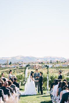 Romantic scenic California summer wedding featured on Cake and Lace blog : Designer wedding dress by Stella York