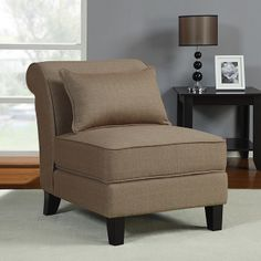 Add style and seating to your living space with this elegant slipper chair. Hardwood legs in a rich espresso finish and luxurious taupe fabric give this chair a sophisticated look, while spring-seat construction and a back pillow make it comfortable.