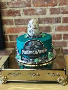 Jurassic Park/world birthday cake. #coolcakes #birthdaycakes #orlandocakes #polkcakes #hainescitybakery #kissimmeecakes #kissimmeebakery #jurassicparkcake #cutthecake #bluecakes