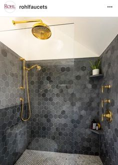 Brass hardware, charcoal hexagon surround shower tile with white grout. Rohl faucets