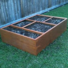 An old entertainment center made into a raised bed. How smart is that!?