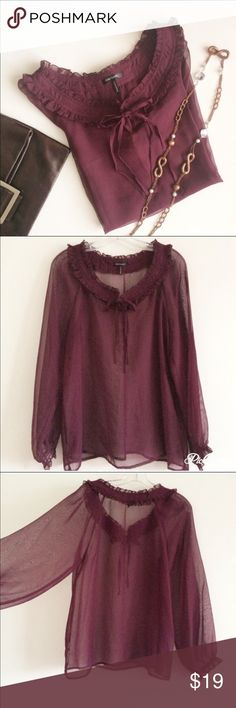 Burgundy Blouse Daisy Fuentes Sheer Burgundy Blouse made of a chiffon like material. It has a pretty embellished collar with 2 ties and long bubble sleeves. Gorgeous with a camisole underneath. New condition except for a small snag on right sleeve (pictured). Tag has been cut, however, blouse is machine washable on delicate cycle in cold water. Lay flat or hang to dry. Daisy Fuentes Tops Blouses