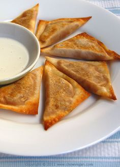 Spicy pumpkin wontons!  24 wonton wrappers  1/2 of a 15 oz can pumpkin puree  3/4″ piece of fresh ginger, minced  1 green onion stalk, finely chopped  1 teaspoon soy sauce  Salt and pepper to taste  Sriracha hot chili sauce to taste  Olive oil  1 package Tofutti cream cheese non-hydrogenated plain