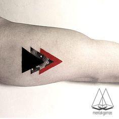 triangle tattoo on arm