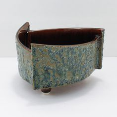 Hi to paulasloft- a shopping experience for unique eclectic vintage home decor!mid centurybeautiful abstract ikebana planter!lovely thick textured glazeblue green over a brown base3 panels 3 feet brutalistvintage condition: beautiful!markings: yamasan logo stamp, #2014measures appx: 6 wide, 4 tallitem weightappx: 2 poundsmid centurythanks for stopping by!other unique vintage ashtrays herepaula at paulasloft