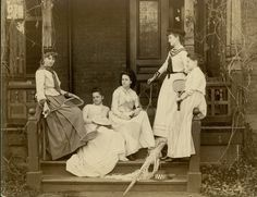 Smith College students in tennis outfits with racquets, on the steps of Washburn House, c.1889