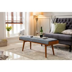 Ideal for small spaces, this mid-century modern style accent bench is a versatile addition to any space. Crafted from solid wood, this bench features a walnut finish with your choice of colored cushio
