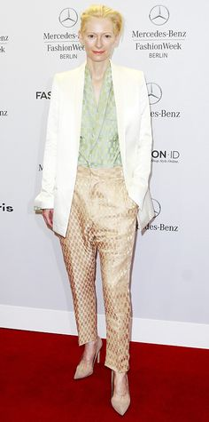 Tilda Swinton color-blocked like a pro from the front seat of the Roshi Porkar spring/summer 2015 show at Berlin Fashion Week with a metallic mint green top and peach trousers, and topped them off with a sharp white blazer, reflective shades and nude pumps.